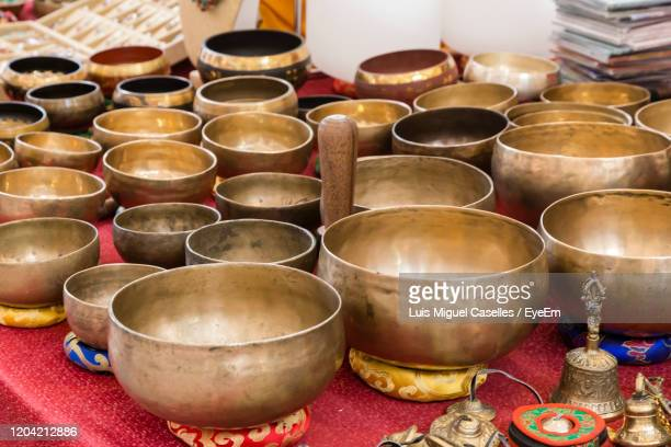 tibetan brass bowl used for medicine relaxation - brass stock pictures, royalty-free photos & images