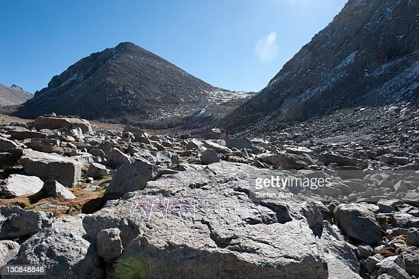 Tibetan Buddhism, Dolma La Pass, 5670 m, pilgrimage route to the sacred Mount Kailash, writing on rock, Gang Rinpoche, Kora, Ngari, Gang-Tise Mountains, Trans-Himalaya, Himalayan, West Tibet, Tibet Autonomous Region, People's Republic of China, Asia