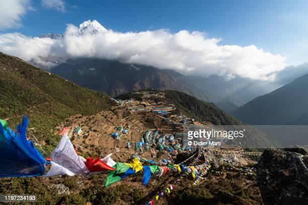tibetan buddhism prayer flagsa bove namche bazar in nepal - khumbu stock pictures, royalty-free photos & images