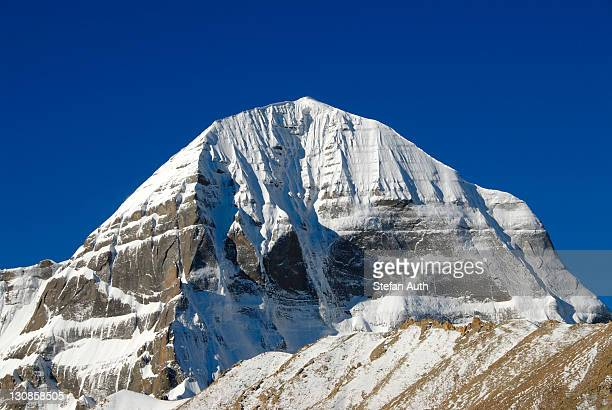 Tibetan Buddhism, snow-capped sacred mountain of Mount Kailash, 6714 m, north side with Kora, Gang Rinpoche and Gang-Tise Mountains, Trans-Himalaya, Himalayas, Western Tibet, Tibet Autonomous Region, People's Republic of China, Asia