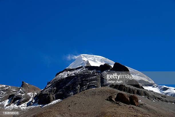Tibetan Buddhism, snow-capped sacred mountain of Mount Kailash with a snow shower, 6714 m, west side with Kora, Gang Rinpoche and Gang-Tise Mountains, Trans-Himalaya, Himalayas, Western Tibet, Tibet Autonomous Region, People's Republic of China, Asia