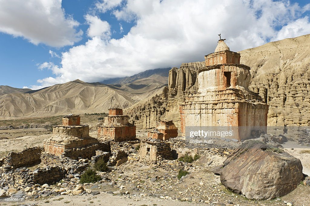 Tibetan Buddhism, weathered stupa in eroded landscape, Ghami, Upper Mustang, Nepal : Stock Photo