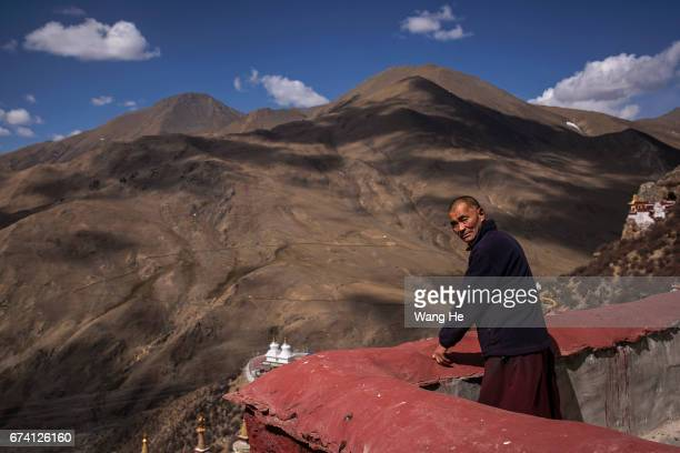 Tibetan buddhist monk walks around the courtyard of the Drak Yerpa on April 27 2017 in LhasaTibet Autonomous Region China Drak Yerpa Hermitage is one...