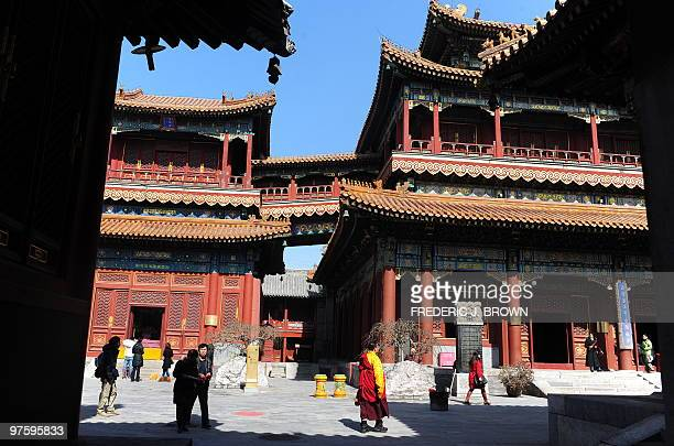 A Tibetan Buddhist monk walks on the grounds of the Yonghegong also known as the Lama Temple a temple and monastery belonging to the Geluk School of...