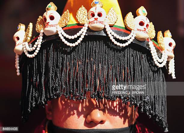 A Tibetan Buddhist monk wears an elaborate head ornament during Cham Dances at ongoing festivities celebrating Monlam or the Great Prayer Festival at...