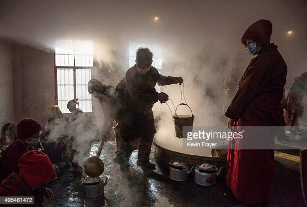 Tibetan Buddhist monks and nuns make tea from yak butter and milk before a morning chanting session at the annual Bliss Dharma Assembly at the Larung...