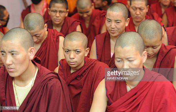 Tibetan Buddhist monks and nuns participate in a sitin solidarity rally against China's rule on Tibet in New Delhi on October 18 2011 Hundreds of...