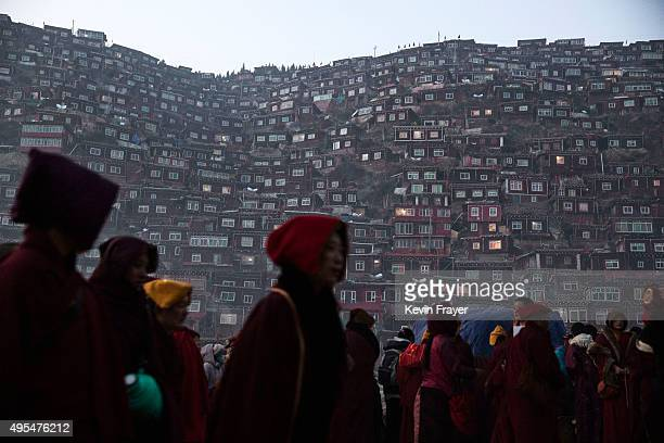 Tibetan Buddhist monks and nuns walk home from the annual Bliss Dharma Assembly at the Larung Wuming Buddhist Institute on November 1 2015 in Sertar...