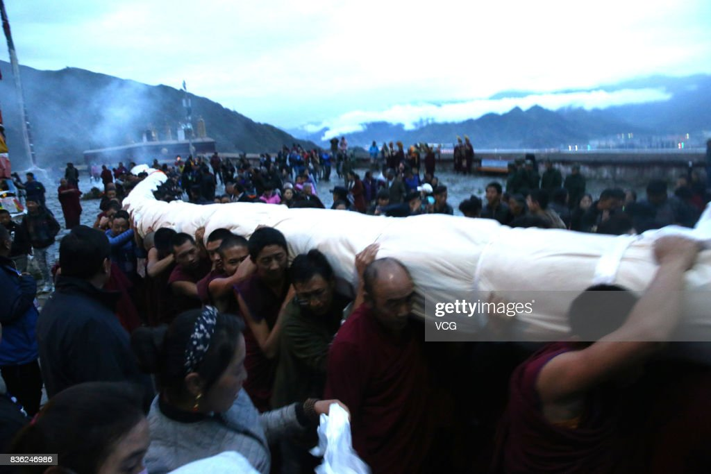 Tibetan buddhist monks carry a large thangka to display during the Sho Dun Festival at Drepung Monastery on August 21, 2017 in Lhasa, China. The Sho Dun Festival, also known as the Yogurt Festival, will run from August 21 to 27.