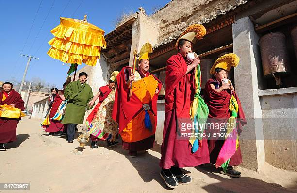 Tibetan Buddhist monks during morning activities leading up to the Sunning of the Buddha when a huge silk thangka showing the image of Sakyamuni the...