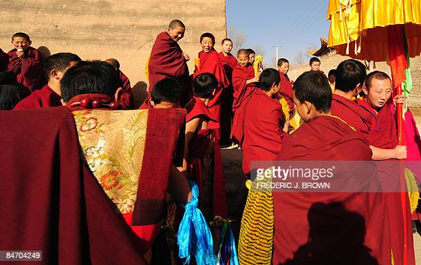 Tibetan Buddhist monks gather ahead of the day's activities for the Sunning of the Buddha at the Nyentog Monastery also known as Nianduhu during...
