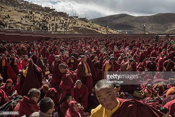 Tibetan Buddhist monks gather during a morning chanting session as part of the annual Bliss Dharma Assembly at the Larung Wuming Buddhist Institute...