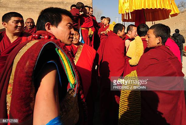 Tibetan Buddhist monks gather for the Sunning of the Buddha during ongoing celebrations for Monlam or the Great Prayer Festival at the Nyentog...