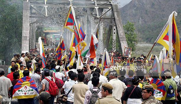 Tibetan Buddhist monks in exile and demonstrators shout anti Chinese slogans at the West BengalSikkim interstate border in Rangpo on March 24 2008...