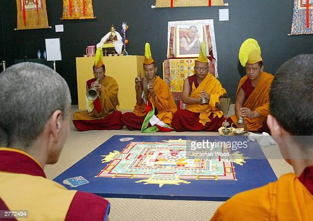 Tibetan Buddhist Monks in prayer during the dissolution of sand mandala at the Queensland Museum, December 1, 2003 in Brisbane, Australia. Tibetan...