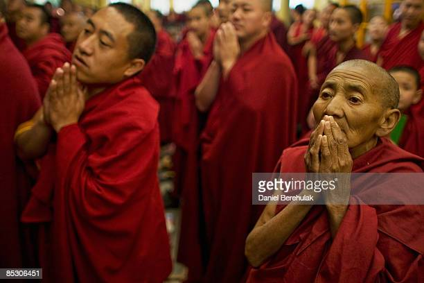Tibetan Buddhist monks inexile pray during a Long Life prayer offerings ceremony to his Holiness the Dalai Lama at the main temple Tsuglag Khang on...
