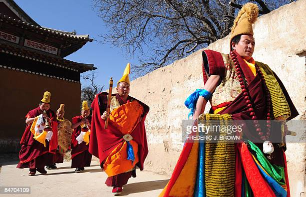 Tibetan Buddhist monks lead a procession to the Sunning of the Buddha when a huge silk thanka showing the image of Sakyamuni the founder of Buddhism...