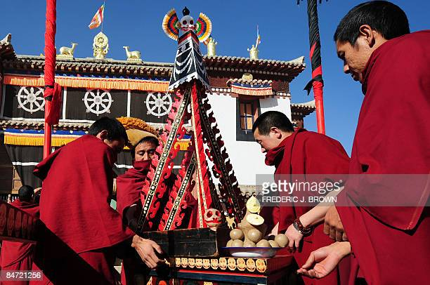 Tibetan Buddhist monks make preparations for Cham Dances during celebrations for Monlam or the Great Prayer Festival at the Gomar Gompa on February 5...