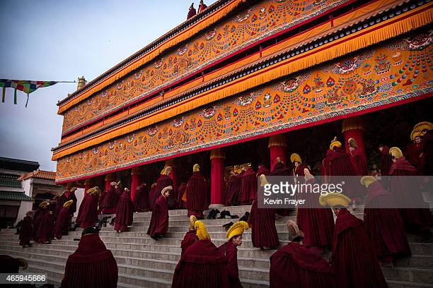 Tibetan Buddhist Monks of the Gelug or Yellow Hat order arrive for morning prayers during Monlam or the Great Prayer rituals on March 3 2015 at the...