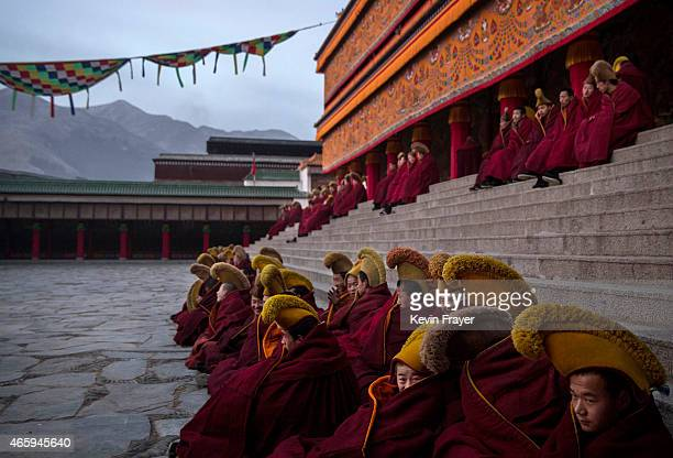Tibetan Buddhist Monks of the Gelug or Yellow Hat order sit before taking part in morning prayers during Monlam or the Great Prayer rituals on March...