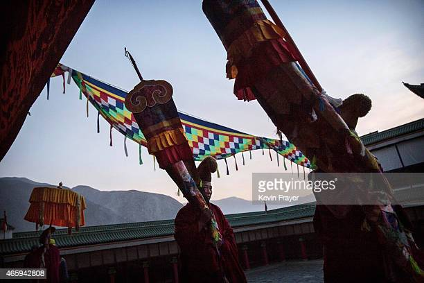 Tibetan Buddhist Monks of the Gelug or Yellow Hat order walk in procession as they make Kora at morning prayers during Monlam or the Great Prayer...