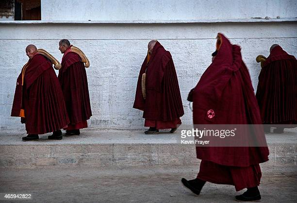 Tibetan Buddhist Monks of the Gelug or Yellow Hat order walk to morning prayers during Monlam or the Great Prayer rituals on March 3 2015 at the...