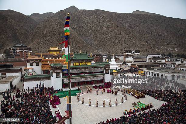 Tibetan Buddhist monks perform a mask dance during Monlam or the Great Prayer rituals on March 4 2015 at the Labrang Monastery Xiahe County Amdo...