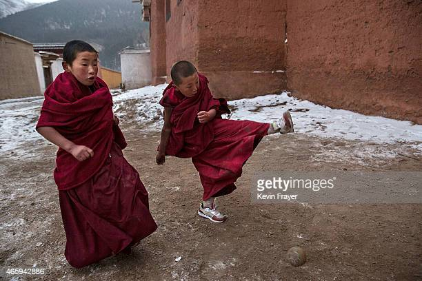Tibetan Buddhist monks play soccer outside their hostel during Monlam or the Great Prayer rituals on March 4 2015 at the Labrang Monastery Xiahe...