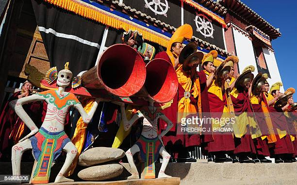 Tibetan Buddhist monks play their instruments at Gomar Gompa in Repkong during ongoing celebrations for Monlam or the Great Prayer Festival on...