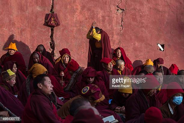 Tibetan Buddhist monks pray during a chanting session as part of the annual Bliss Dharma Assembly at the Larung Wuming Buddhist Institute on October...