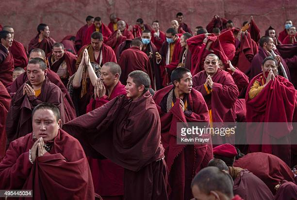 Tibetan Buddhist monks pray during a morning chanting session as part of the annual Bliss Dharma Assembly at the Larung Wuming Buddhist Institute on...