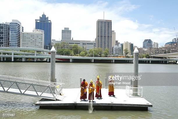 Tibetan Buddhist Monks release a sand Mandala into the Brisbane River at the Queensland Museum, December 1, 2003 in Brisbane, Australia. Tibetan...