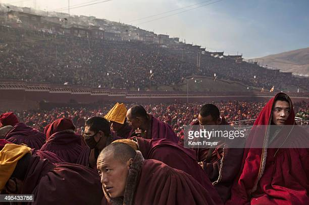 Tibetan Buddhist monks sit during a morning chanting session as part of the annual Bliss Dharma Assembly at the Larung Wuming Buddhist Institute on...