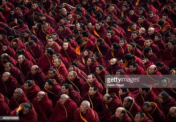 Tibetan Buddhist monks take part in a special prayer during Monlam or the Great Prayer rituals on March 5 2015 at the Labrang Monastery Xiahe County...