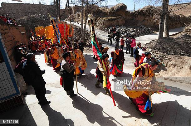 Tibetan Buddhist monks walk in a procession leading up to the Sunning of the Buddha when a huge thangka of Sakyamuni the founder of Buddhism is...