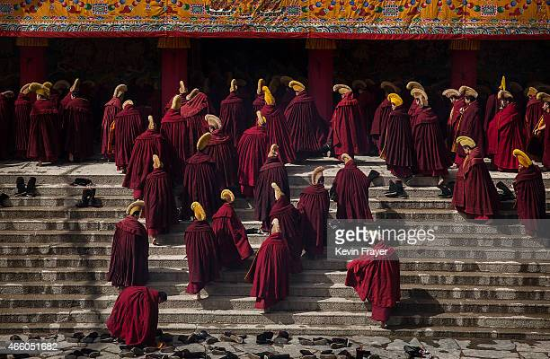 Tibetan Buddhist monks walk to prayerr during Monlam or the Great Prayer rituals on March 5 2015 at the Labrang Monastery Xiahe County Amdo Tibetan...