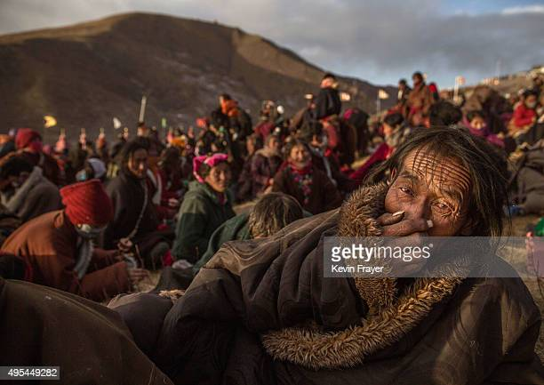 Tibetan Buddhist nomads listen during the annual Bliss Dharma Assembly at the Larung Wuming Buddhist Institute on October 31 2015 in Sertar county in...