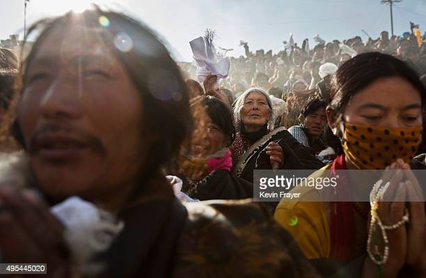 Tibetan Buddhist nomads pray during a morning chanting session as part of the annual Bliss Dharma Assembly at the Larung Wuming Buddhist Institute on...