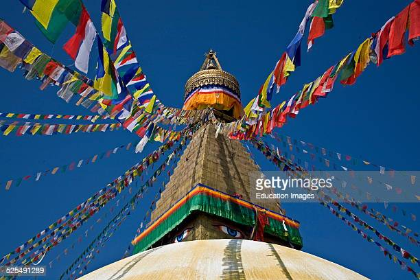 Tibetan Buddhist Prayer Flags Fly From The Top Of Bodhanath Stupa, Kathamandu, Nepal.