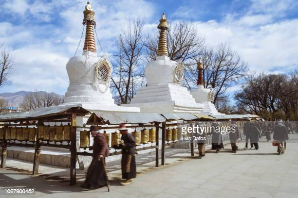 Tibetan Buddhist stupas and pilgrims