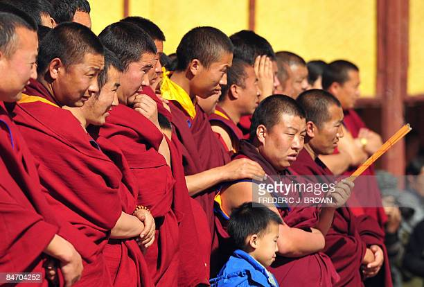 Tibetan Buddhist watch activities ahead of the Sunning of the Buddha at the Nyentog Monastery also known as Nianduhu during celebrations for the...