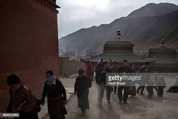 Tibetan Buddhists make Kora during Monlam or the Great Prayer rituals on March 3 2015 at the Labrang Monastery Xiahe County Amdo Tibetan Autonomous...