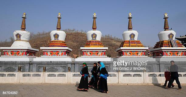 Tibetan Buddhists make their clockwise circular trek around stupas at the Kumbum Monastery outside of Xining on February 7 2009 in northwest China's...
