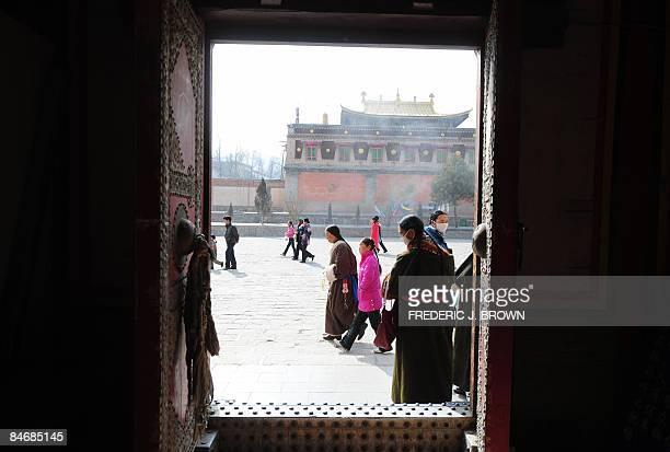 Tibetan Buddhists make their clockwise circular trek around the Kumbum Monastery outside of Xining on February 7 2009 in northwest China's Qinghai...