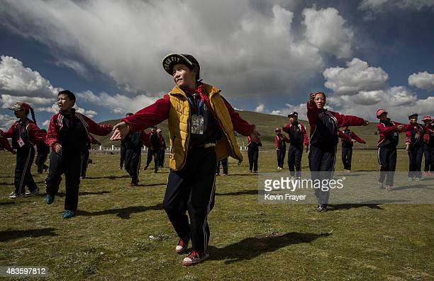 Tibetan children exercise as they take aprt in a camp at a Chinese government school in a resettlement community for nomads on July 24 2015 on the...