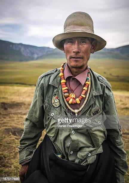 Tibetan cowboy from the Yellow Hat sect wearing a US Army jacket in the grasslands on September 1, 2011 in Langmusi, China.