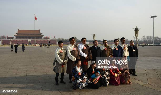 Tibetan Delegation poses in front of Tiananmen before the seventh plenary session of the 13th National People's Congress at the Great Hall of the...