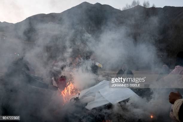 Tibetan devotees burn incense outside the Labrang Temple during Tibetan New Year celebrations in Labrang on the QinghaiTibet Plateau on February 27...