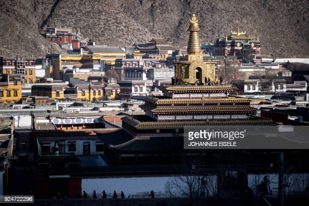 Tibetan devotes circle the Labrang Temple during Tibetan New Year celebrations in Labrang on the QinghaiTibet Plateau on February 27 2018 The Tibetan...