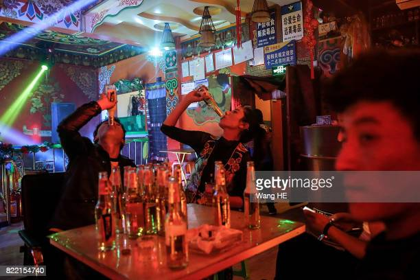 Tibetan drink beer in Tibetan Bar on July 22 2017 in Litang County southwest of Garze Tibetan Autonomous Prefecture Sichuan China Litang Town is...